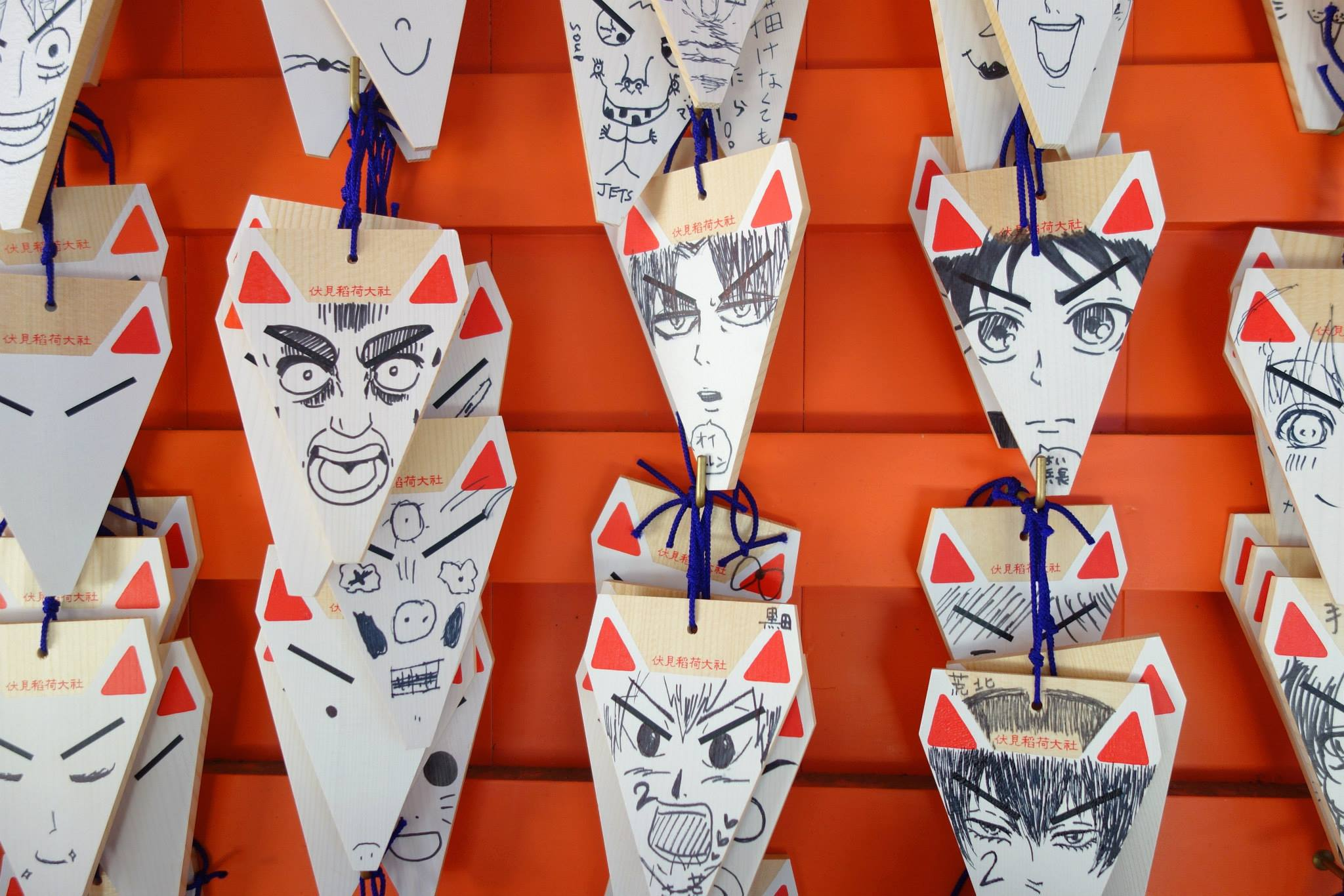 Wall of Fox's at Fushimi Inari Shrine